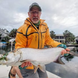 a fly fisherman with a tarpon