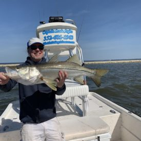 a fisherman with a snook
