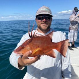 a fisherman with a hogfish