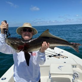 a fisherman with a cobia