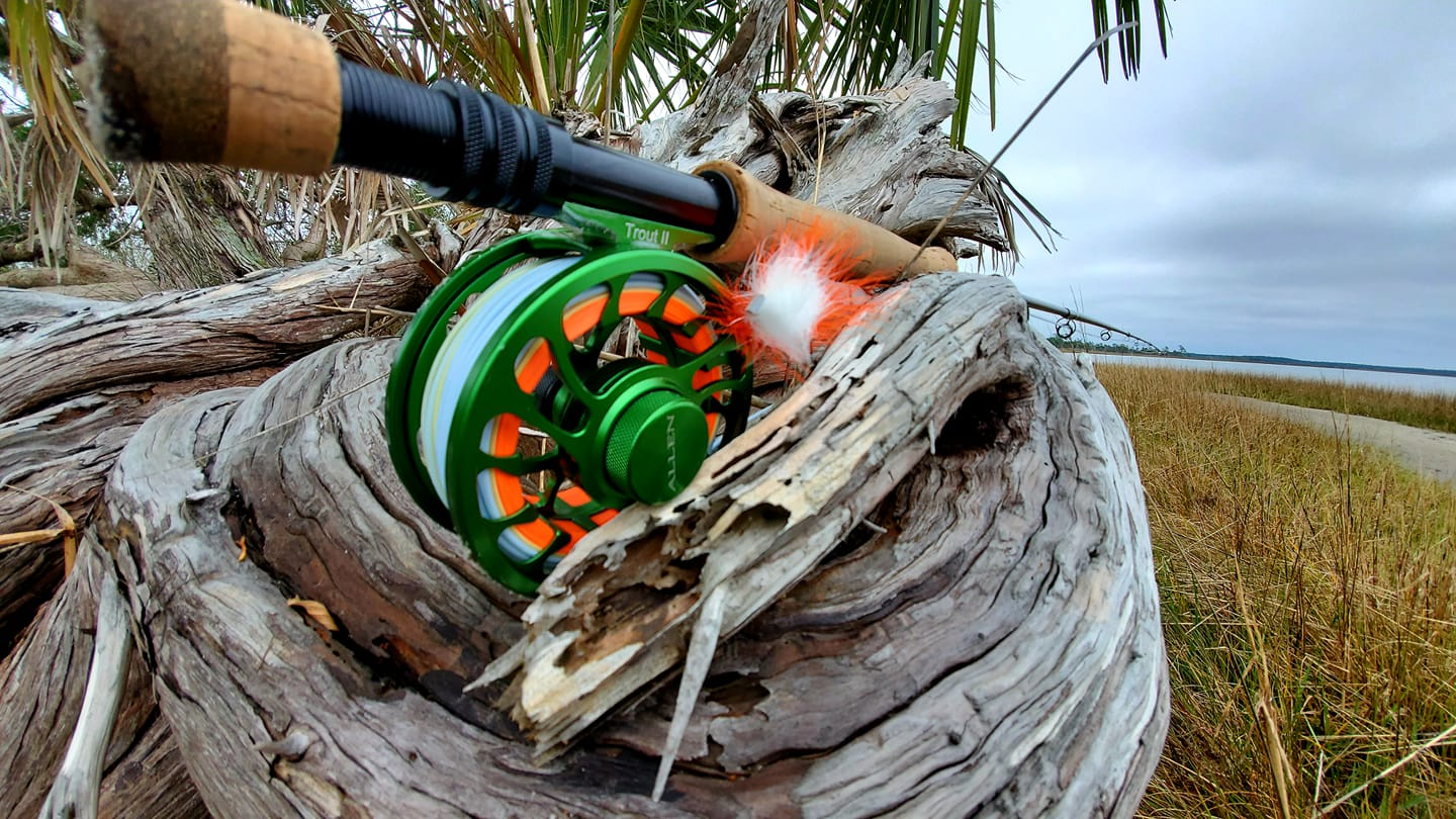 a fly rod sitting on the shore in Crystal River, Florida