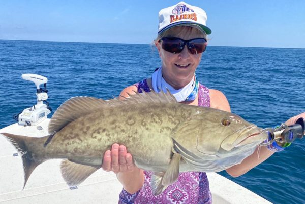 a fisherman with a grouper