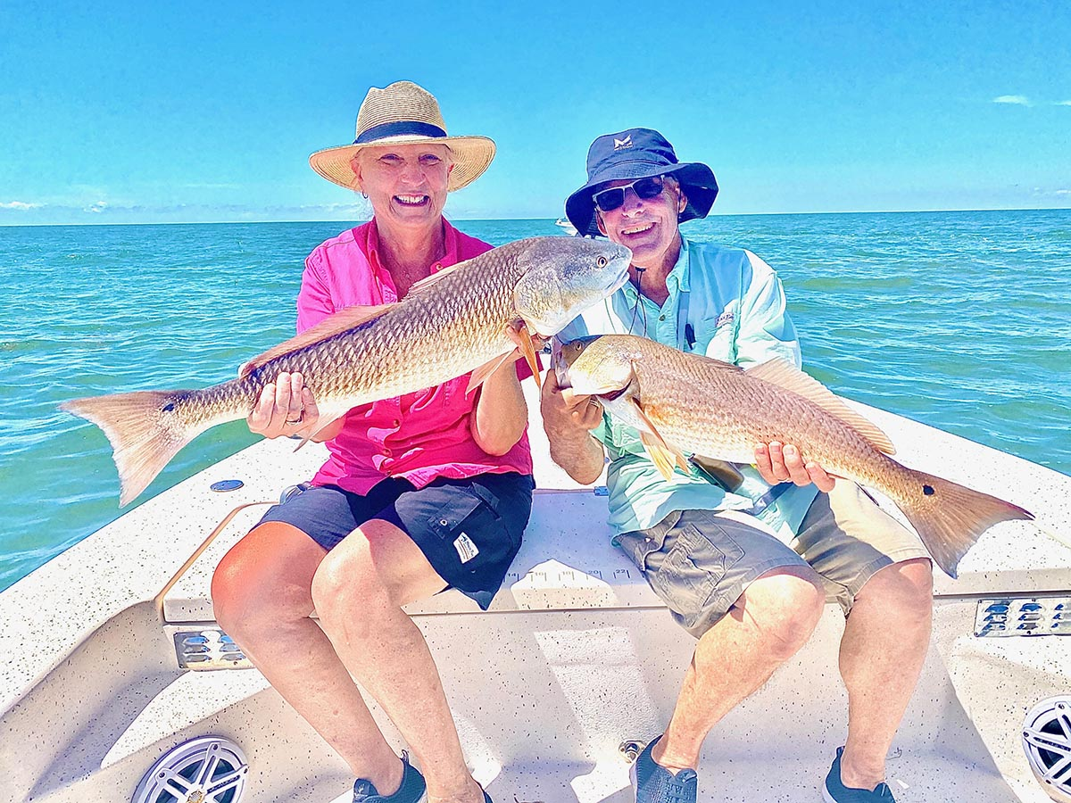 two fisherman showing redfish they caught on a crystal river inshore fishing charter