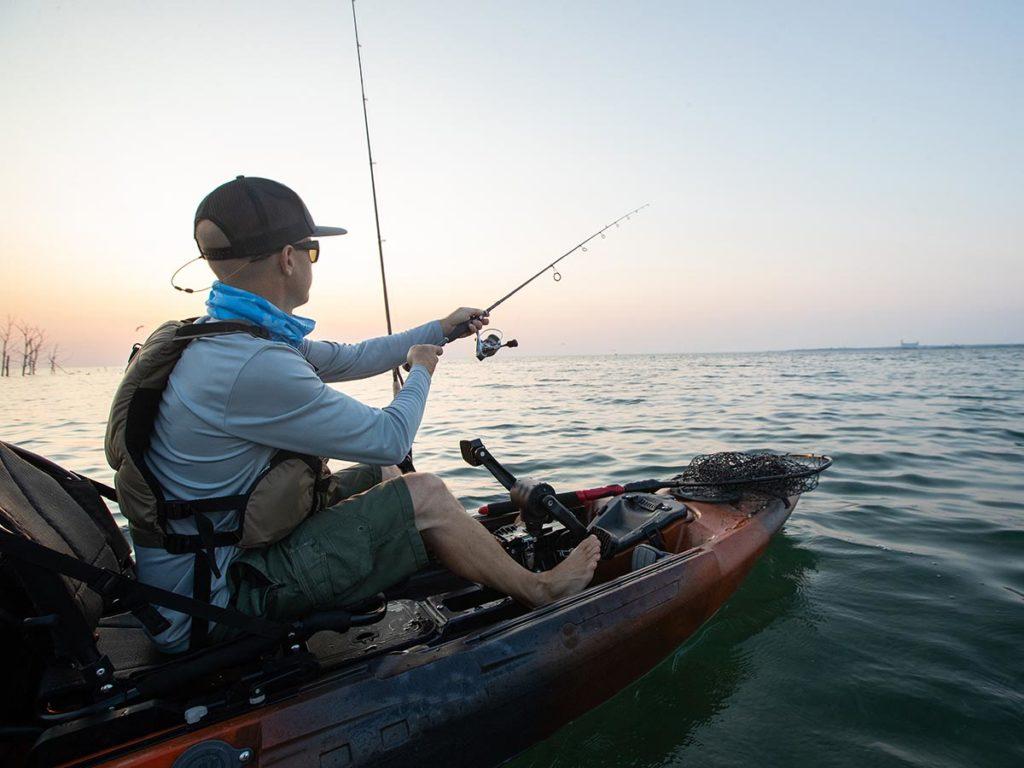 a fisherman on a kayak fishing charter